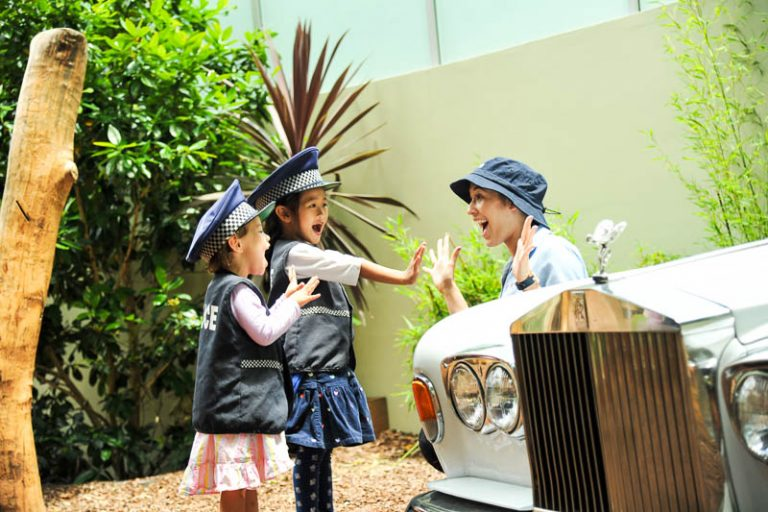 children playing pretend dressed as police