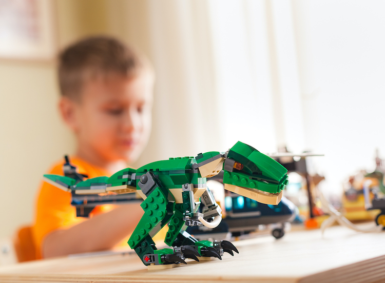 Toddler playing with lego